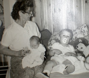 Ottilie holds baby Sharon in her lap. Older brother Michael is next to her